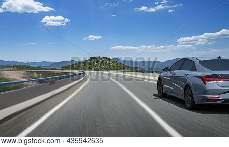 The Car Is Moving Along A Beautiful Mountain Road.