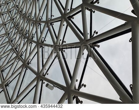 Steel Structure Geometry Construction As The Background. Structural Glass Facade Curving Roof, Abstr