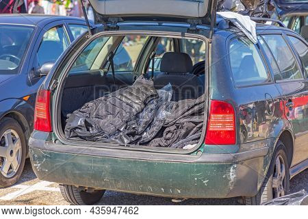 Selling New Winter Jackets From Car Booth