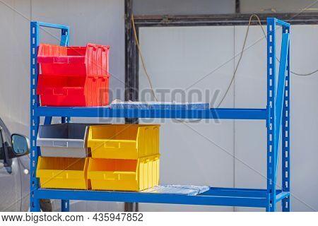 Plastic Tray Bins At Shelf In Garage Storage Space