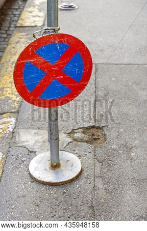 Movable No Parking Sign Column At City Street