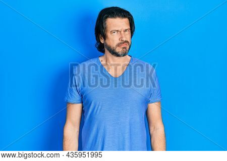 Middle age caucasian man wearing casual clothes skeptic and nervous, frowning upset because of problem. negative person.