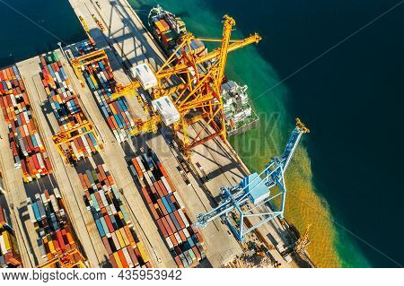 Containers In International Shipping Dock Waiting To Import Or Export And Transportation. Top View O