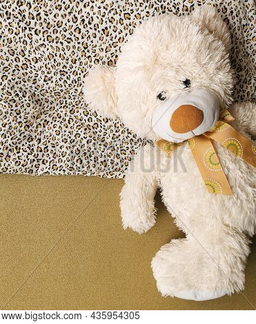 Single, Alone, Lonely Teddy Bear In Bed Is Lying On The Pillow And Waiting For Someone To Sleep With