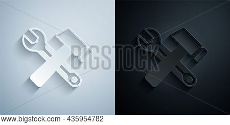 Paper Cut Crossed Hammer And Wrench Spanner Icon Isolated On Grey And Black Background. Hardware Too