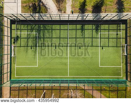Drone View Of Street Soccer Court. Outdoor Sport Ground With Green Surface For Playing Football  Or