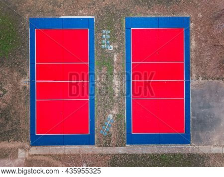 Aerial View Of A Red And Blue  Outdoor Volleyball Fields. Outdoor Sport Grounds With Red And Blue Pl