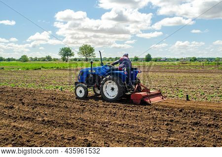 Kherson Oblast, Ukraine - May 28, 2020: A Farmer Is Cultivating A Field Before Replanting Seedlings.