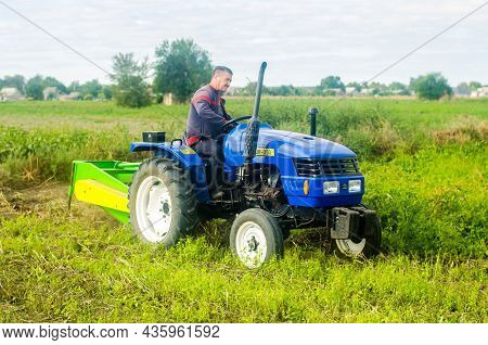 Kherson Oblast, Ukraine - September 19, 2020: A Farmer On A Tractor Digging Out Potato. Farming And