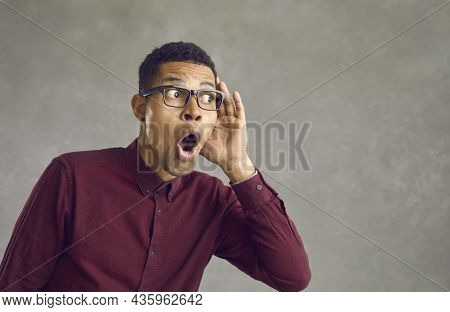 Curious Black Man Holding Hand At Ear Listening To Shocking News Or Somebodys Secret