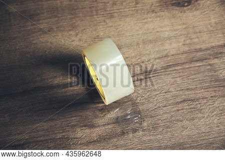 Scotch Tape On A Wooden Table Background.