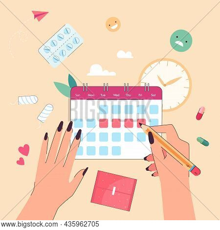 Hands Of Woman With Calendar Of Menstrual Period. Girl Marking With Pencil Dates Of Menses Monthly F