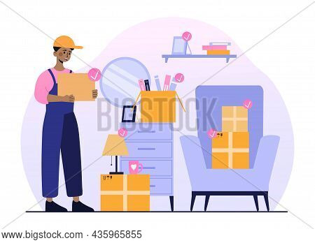 Young Man Moving House. African American Loader Puts Things In Boxes. Moving From One Apartment To A