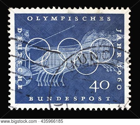 ZAGREB, CROATIA - JUNE 27, 2014: Stamp printed in Germany showing Chariot Race, Sport Scene from Greek vase paintings, Olympic rings and promotes 17th Olympic Games in Rome, circa 1960