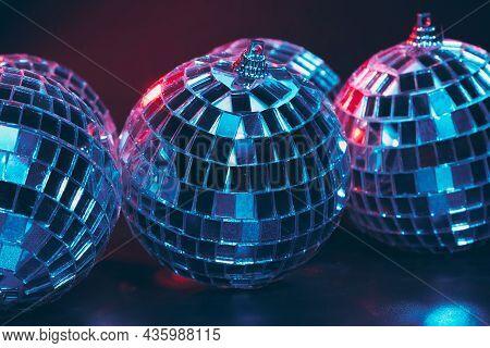 Group Of Shiny Disco Balls On Dark Background Close Up