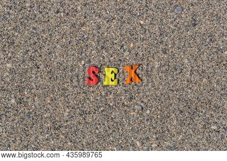 Multicolored Inscription Sex On The Sand. Yellow, Red, Orange Wooden Letters. Romantic Caption For A
