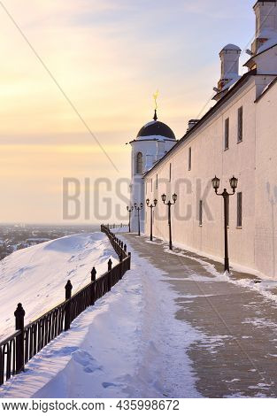 Tobolsk Kremlin In Winter. White Stone Fortress Walls On A High Hill. Old Russian Architecture Of Th