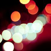 Blurred defocused lights background of city at night. Bokeh sparkling lights. poster