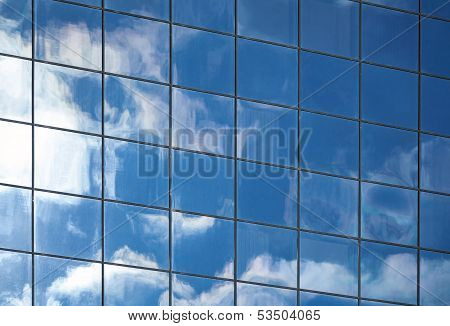 Abstract Background Texture With Clouds Reflected In Windows Of Modern Office Building