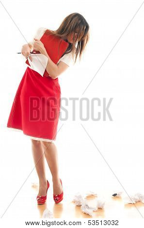 Attractive business woman pulling out sheets of notebook while standing on a white background poster