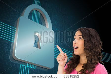 Composite image of surprised brown haired woman pointing out poster
