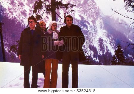 Vintage photo (scanned reversal film) - mature parents with son and daughter-in-law in mountains, seventies