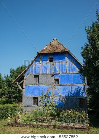blue stucco half-timbered house, France