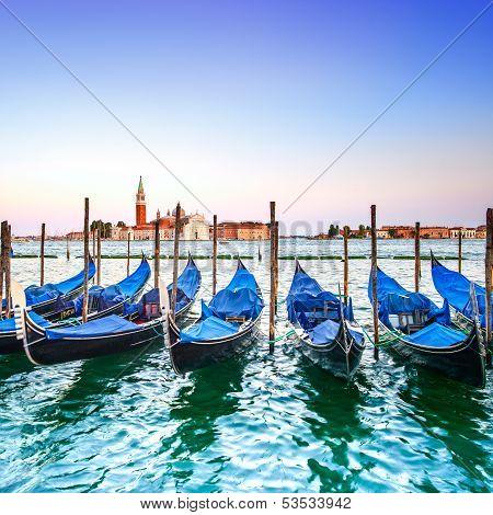 Venice Sunset, Gondolas Or Gondole And Church On Background. Italy