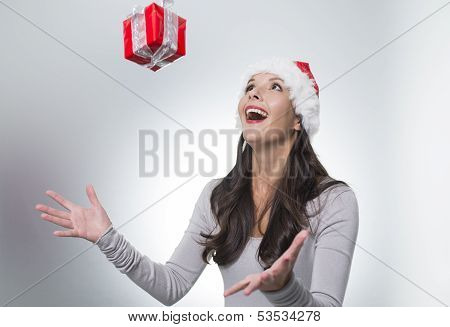 Laughing Woman Catching A Surprise Christmas Gift