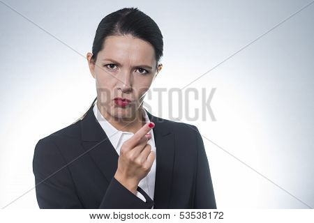 Stern Young Woman Making A Finger Gesture