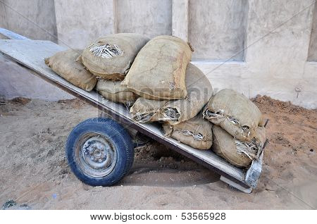 Holey bags on a cart.