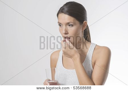 Attractive Woman Taking Medication