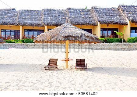 beds and umbrella on the beach