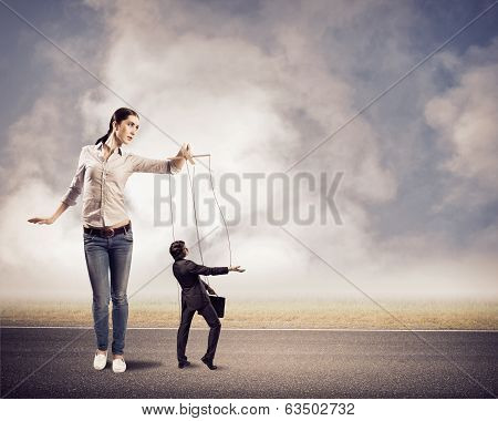 puppeteer controls a businessman