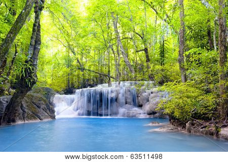 Waterfall in tropical forest nature landscape background