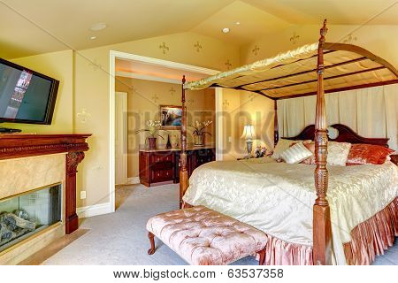 Luxury House Interior. Beautiful Bed With High Posts