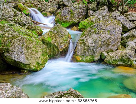 Waterfall In Mountain Rainforest