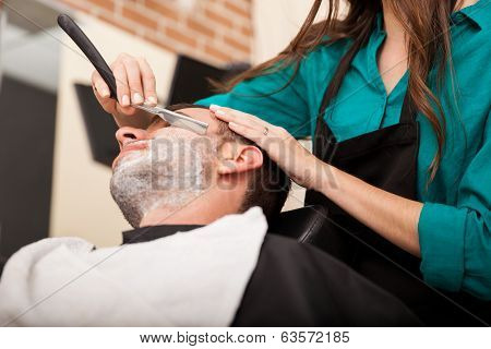 Young Man Getting A Shave