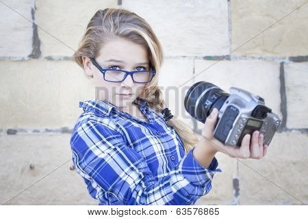 Funky cool contemporary teenager with glasses and a camera taking self portrait a selfie soft focus poster