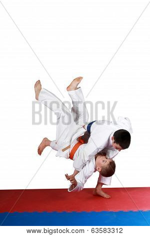On the red and blue mat boys are training throw poster