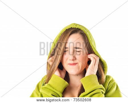 Young Pretty Girl Covering Her Ears Over White Background