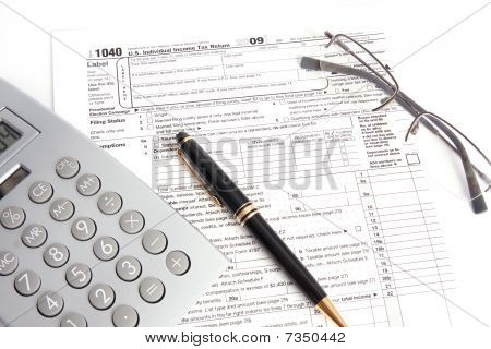 Calculator Tax Form And Pen