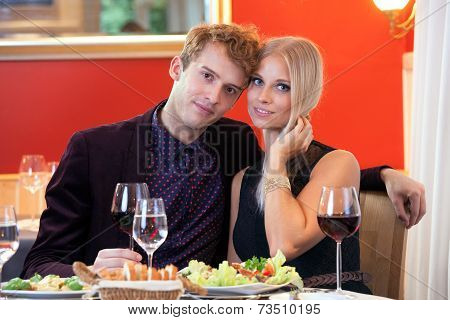 Sweet Young Couple Having Date At Restaurant