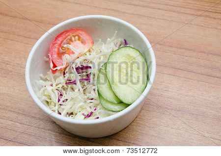 Tomato, Cucumber And Cabbage Salad In A White Bowl