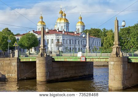 view of St. Nicholas Naval Cathedral from the Pikalov bridge in St. Petersburg, Russia poster