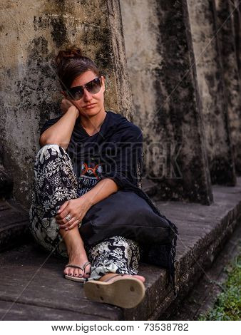 Woman Sitting And Waiting Beside Angkor Wat Temple In Cambodia