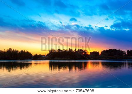 Amazing sunset sky reflection on the river
