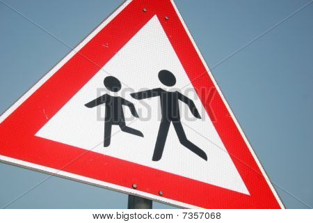 Warning sign of playing childs near a school