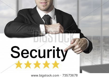 Businessman Pointing On Sign Security