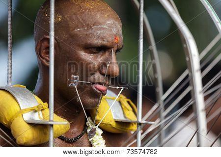 BATU CAVES, MALAYSIA, FEBRUARY 07, 2012: Hindu devotee in annual Thaipusam religious festival in Batu Caves, near Kuala Lumpur, Malaysia